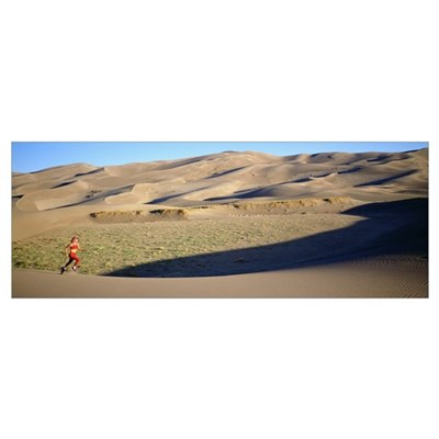 Side profile of a woman running in the desert, Gre Poster