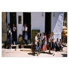 Schoolgirls and schoolboys walking in the street,