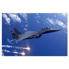 An Air Force F15E Strike Eagle fires flares off th Poster