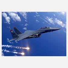 An Air Force F15E Strike Eagle fires flares off th
