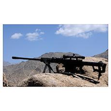 A Barrett .50-caliber M107 Sniper Rifle sits atop Poster