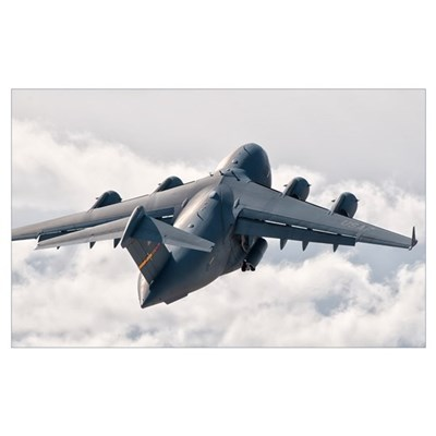 A C-17 Globemaster flying above the clouds over Ne Poster