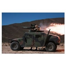 A missileman firing a BGM-71 TOW missile atop a hu Poster
