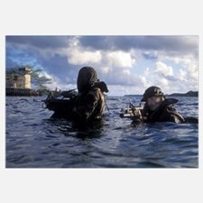 A pair of Navy SEAL combat swimmers transition fro