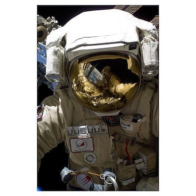 A Russian cosmonaut wearing a Russian Orlan-MK spa Poster
