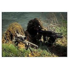A SEAL Sniper swim pair set up an observation post
