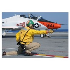 A shooter signlas the launch of a T-45A Goshawk tr Canvas Art