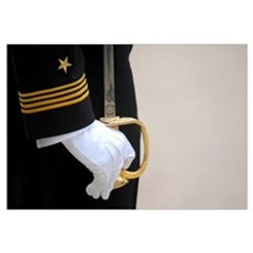 A U.S. Naval Academy midshipman stands at attentio Framed Print