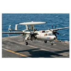 A US Navy E-2C Hawkeye prepares to land aboard USS Poster