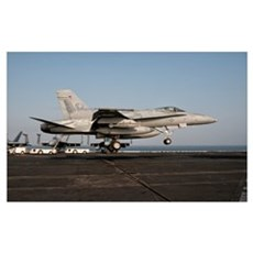 A US Navy F/A-18C Hornet prepares to land aboard U Canvas Art