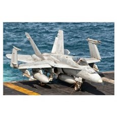 A US Navy F/A-18C Hornet tied on the flight deck o Poster