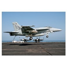 A US Navy F/A-18E Super Hornet prepares to land ab Canvas Art