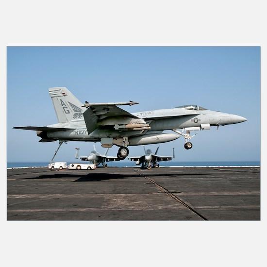 A US Navy F/A-18E Super Hornet prepares to land ab