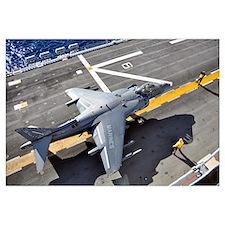An AV-8B Harrier prepares to takeoff from USS Pele