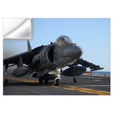 An AV-8B Harrier launches from the flight deck of  Wall Decal