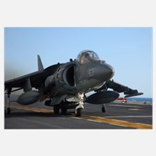 An AV-8B Harrier launches from the flight deck of