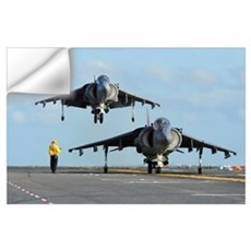 An AV-8B Harrier prepares for takeoff as another l Wall Decal