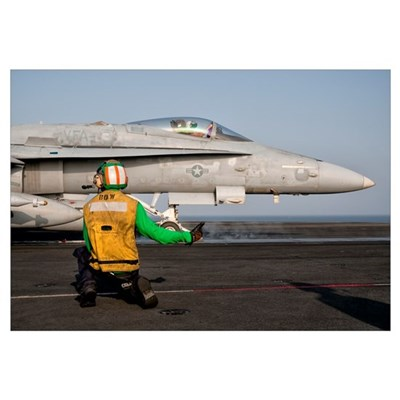 An F/A-18C is ready to launch from the flight deck Canvas Art