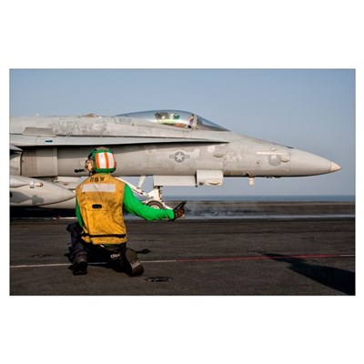 An F/A-18C is ready to launch from the flight deck Poster