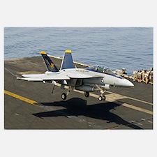 An F/A-18E Super Hornet trap landing on the flight