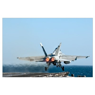 An F/A-18F Super Hornet launches from the flight d Poster
