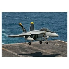 An F/A-18F Super Hornet prepares to land aboard US Canvas Art