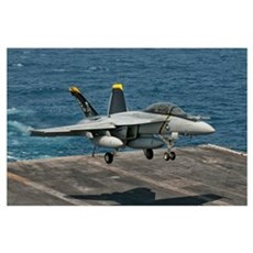 An F/A-18F Super Hornet prepares to land aboard US Poster