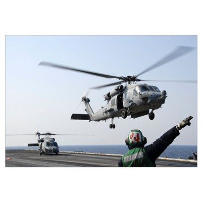 An HH-60H Sea Hawk helicopter takes off from USS R Framed Print