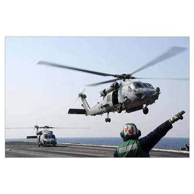 An HH-60H Sea Hawk helicopter takes off from USS R Poster