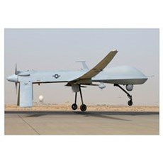 An MQ-1 Predator prepares for takeoff Poster