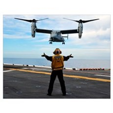 An MV-22 Osprey tiltrotor aircraft approaches the Poster