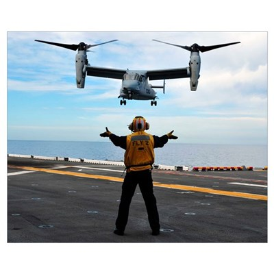 An MV-22 Osprey tiltrotor aircraft approaches the Framed Print