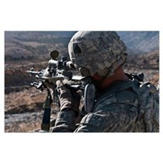 U.S. Army sniper scans a village in Afghanistan fo Poster