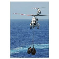 Two SA-330 Puma helicopters deliver pallets