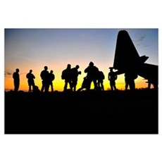 Green Berets prepare to board a KC-130 aircraft Framed Print