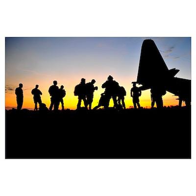 Green Berets prepare to board a KC-130 aircraft Poster