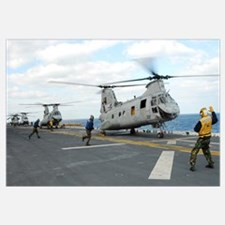 Ground crew prepares CH-46E Sea Knight helicopters
