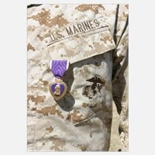 The Purple Heart award hangs over the heart of a U