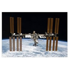 The International Space Station in orbit above Ear Canvas Art