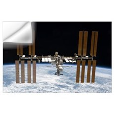 The International Space Station in orbit above Ear Wall Decal