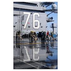 Sailors scrub the flight deck aboard the aircraft  Poster