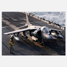 Sailors prepare an AV-8B Harrier jet aircraft for