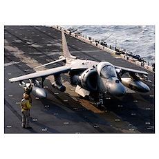 Sailors prepare an AV-8B Harrier jet aircraft for  Poster