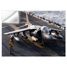 Sailors prepare an AV-8B Harrier jet aircraft for  Wall Decal