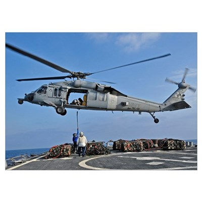 Sailors attach a cargo pennant to a MH-60S Sea Haw Poster
