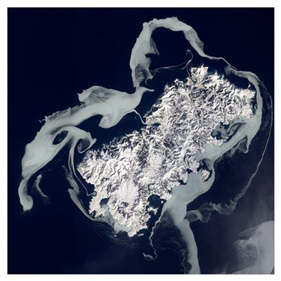 Sea ice surrounds the volcanic island of Shikotan Poster