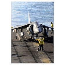 Sailors prepare to launch an AV-8B Harrier during