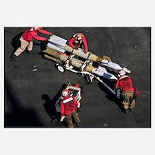 Marines push pordnance into place on the flight de