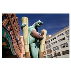 Low angle view of the statue of a dinosaur in a ma Poster