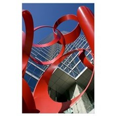 Low angle view of a sculpture in front of a buildi Poster